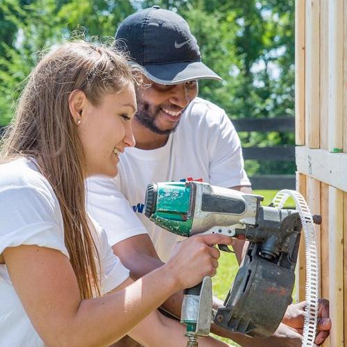 Volunteers building a horse barn